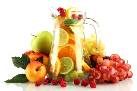transparent jar with exotic  fruits, isolated on white photo