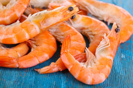 Shrimps on blue wooden table photo