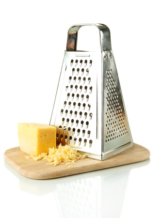 grater: Metal grater and cheese on cutting board, isolated on white