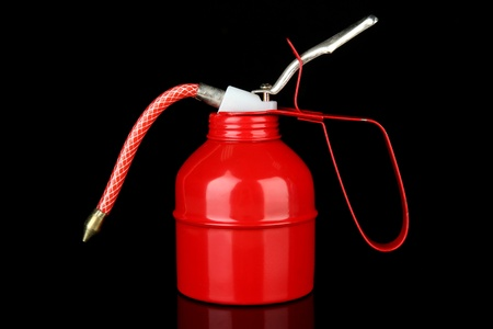 Red oil can, isolated on black Stock Photo - 19099544