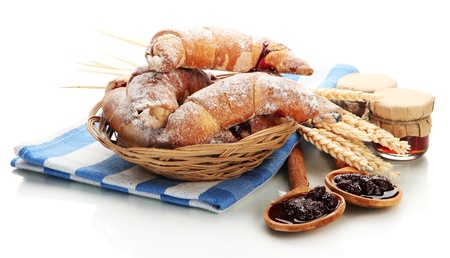 traditionally french: Taste croissants in basket and jam isolated on white  Stock Photo