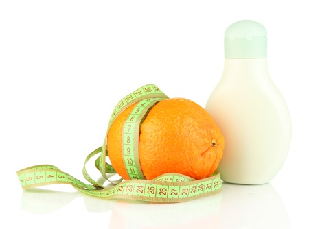 Orange with measuring tape and body cream, isolated on white Stock Photo - 19099568