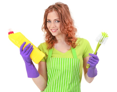 Young woman wearing rubber gloves with cleaning supplies, isolated on white photo