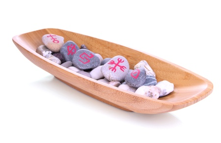 Fortune telling  with symbols on stones in wooden bowl isolated on white Stock Photo - 19100656