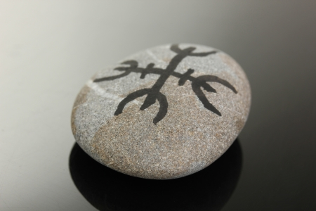 Fortune telling  with symbols on stone on black background Stock Photo - 19100831