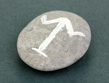 Fortune telling  with symbols on stone on grey background Stock Photo - 19100828