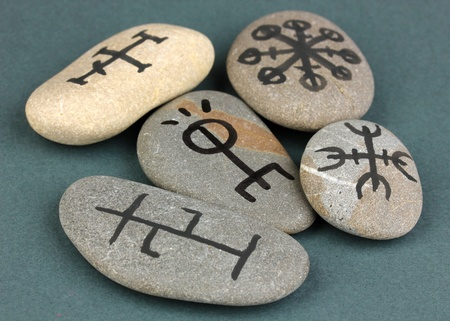 Fortune telling  with symbols on stones on grey background Stock Photo - 19101440