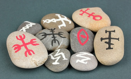 Fortune telling  with symbols on stones on grey background Stock Photo - 19100883