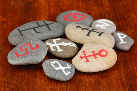 Fortune telling  with symbols on stones on wooden background Stock Photo - 19101429