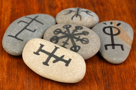 Fortune telling  with symbols on stones on wooden background Stock Photo - 19100928