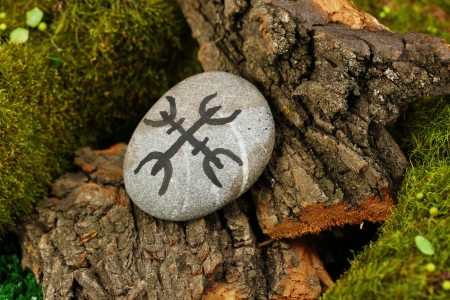 Fortune telling  with symbols on stone close up Stock Photo - 19101480