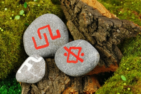 Fortune telling  with symbols on stone close up Stock Photo - 19101482