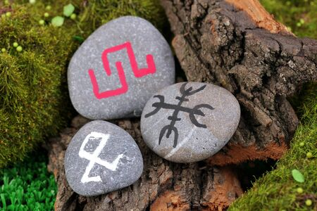 Fortune telling  with symbols on stone close up Stock Photo - 19101452