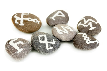 Fortune telling  with symbols on stones isolated on white Stock Photo - 19100741