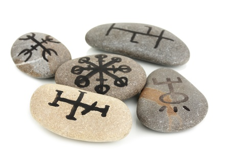 Fortune telling  with symbols on stones isolated on white Stock Photo - 19100787
