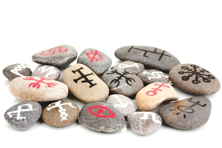 Fortune telling  with symbols on stones isolated on white Stock Photo - 19100867