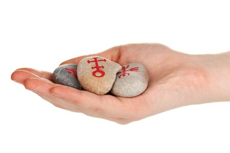 Fortune telling  with symbols on stone in hand isolated on white Stock Photo - 19100645