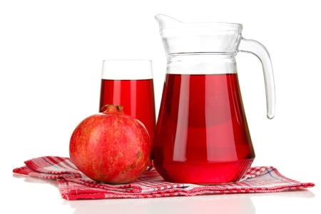 Full glass and jug of pomegranate juice and pomegranate isolated on white photo