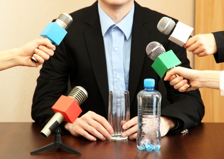 debating: Conference meeting microphone with businessman or politician Stock Photo