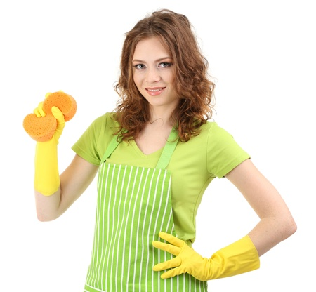 Young woman wearing green apron and rubber gloves with sponge, isolated on white