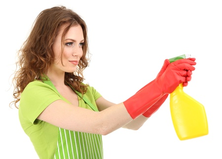 Young woman holding sprayer, isolated on white photo