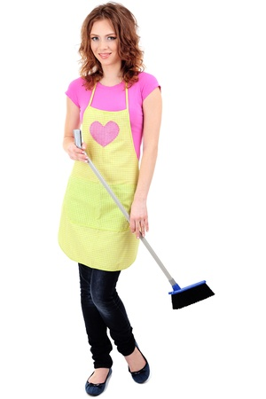 Young housewife with broom and dustpan, isolated on white photo