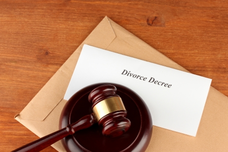 decree: Divorce decree and wooden gavel on wooden background Stock Photo
