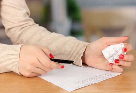 write off: Write off exam on wooden table on room background Stock Photo