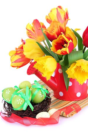 Easter composition with fresh tulips and easter eggs isolated on white photo
