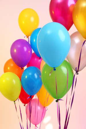 balloon background: Many bright balloons on orange background
