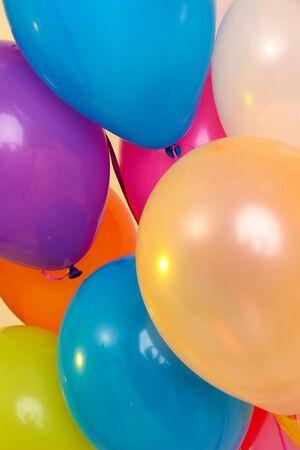 Many bright balloons close-up photo
