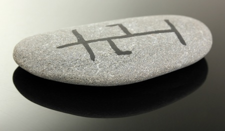 Fortune telling  with symbols on stone on black background Stock Photo - 19270977