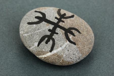 Fortune telling  with symbols on stone on grey background Stock Photo - 19271624