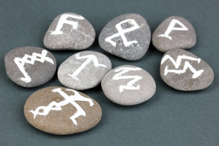 Fortune telling  with symbols on stones on grey background Stock Photo - 19271554