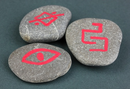 Fortune telling  with symbols on stones on grey background Stock Photo - 19271609
