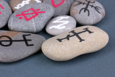 Fortune telling  with symbols on stones on grey background Stock Photo - 19271607