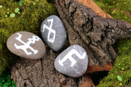 Fortune telling  with symbols on stone close up photo