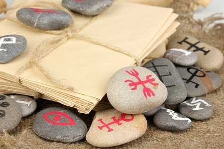 Fortune telling  with symbols on stones on burlap background photo