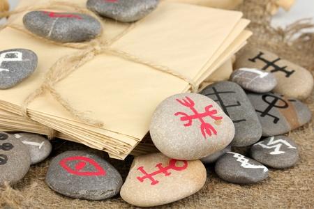Fortune telling  with symbols on stones on burlap background Stock Photo - 19271608