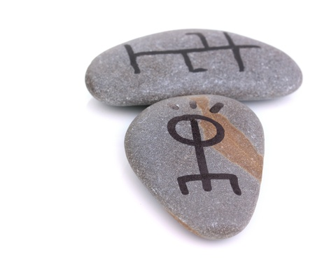 Fortune telling  with symbols on stones isolated on white Stock Photo - 19251891