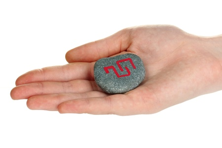 Fortune telling  with symbols on stone in hand isolated on white Stock Photo - 19260631