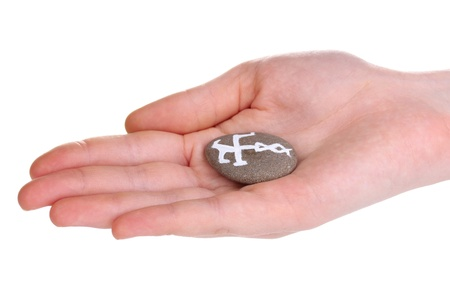 Fortune telling  with symbols on stone in hand isolated on white Stock Photo - 19260600