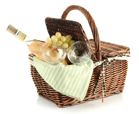 Picnic basket with grape and bottle of wine, isolated on white photo
