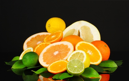 Lots ripe citrus isolated on black photo