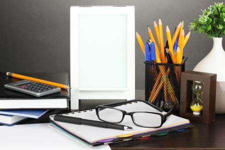 White photo frame on office desk on grey background Stock Photo - 19319798