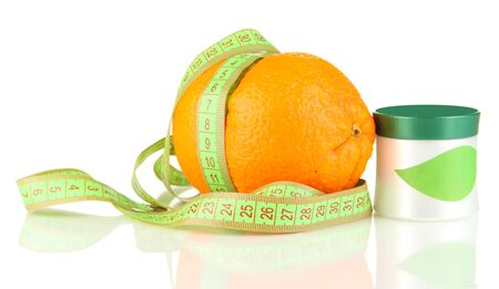 Orange with measuring tape and body cream, isolated on white photo