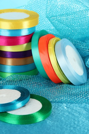 Bright ribbons on blue background photo