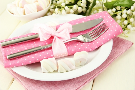 Table setting in white and pink tones on color  wooden background Stock Photo - 19320144