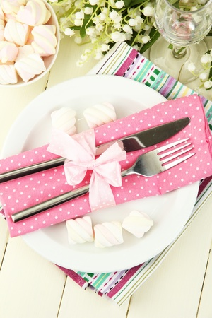 Table setting in white and pink tones on color  wooden background Stock Photo - 19320223