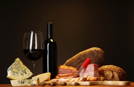 bread and wine: Exquisite still life of wine, cheese and meat products Stock Photo